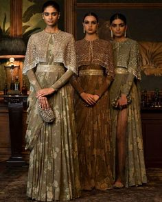 saree style gowns with a tassled cape by indian fashion designer sabyasachi mukherjee Indian Attire, Indian Ethnic Wear, Indian Wedding Outfits, Indian Outfits, Wedding Dress, Boho Wedding, Pakistani Dresses, Indian Dresses, Indian Designer Outfits