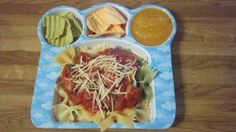 Tonight's special. Tri-color bowtie pasta with organic garden vegetable spaghetti sauce and mini meatballs made from a veggie burger. Sides include pineapple applesauce and veggie chips. I wonder how many servings of vegetables this amounts to? Hit or miss? Hit!