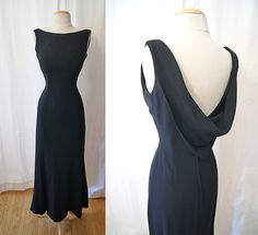 Sexy 1950's black crepe floor length formal gown with  fish tail  hem and gorgeous shawl back bombshell chic - size Small to Medium. $245.00, via Etsy.