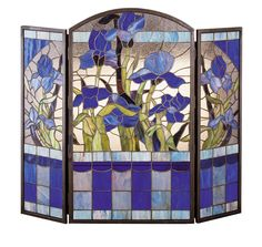 """FREE Shipping Meyda Tiffany Custom Made to Order SKU 27236 40""""W X 34""""H Iris Fireplace Screen Colors Zaz Lt Blue Purple / Blue Purple / Blue Availability Currently In Stock Meyda Tiffany's original Iris design celebrates thebeauty of the flower named for Juno's messenger who wasturned into a rainbow. Purple Iris flowers and SpringGreen leaves adorn a Clear textured background accentedwith Sky Blue. The charming fireplace screen ishandcrafted of 371 pieces of stained art glassutilizing the…"""