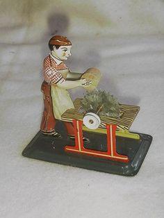 Vintage West German Man Sawing Log Tin Toy