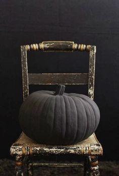 Matte black painted pumpkins make for great no-carve Halloween decor