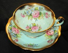 EB FOLEY GOLD WIDE PINK ROSE BOUQUET PASTEL BLUE TEA CUP AND SAUCER