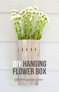 Paint sticks are an inexpensive item that can be used for so many #DIY projects! Use them with Elmer's Wood Glue and wood stain to create easy flower boxes for your home.