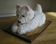 The sweetest Westie in the world! Julie Cains Cakes has been busy again topping our charts with this absolutely stunning hand carved cakes. All the fur has been made with individual rolls of sugarpaste. Very impressive, you have to agree on that one.