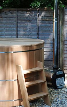 Chofu wood-fired hot tub heater. We'd pair this with a galvanized stock tank rather than the redwood-staved jobby you see here...