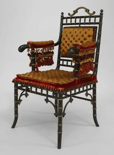 French Victorian faux-bamboo design ebonized and gilt-trimmed armchair: High Victoriana