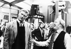 John Wayne is only joking with Richard Attenborough after a punch had been thrown in their mock-fight scene July 1974