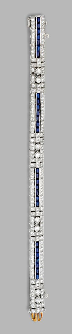 PLATINUM, DIAMOND AND SAPPHIRE BRACELET, TIFFANY & CO., CIRCA 1925.  Set with old European-cut and French-cut diamonds weighing approximately 6.40 carats, accented by calibré-cut sapphires, length 6 3/8  inches, signed Tiffany & Co.