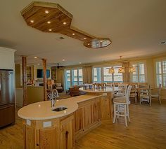 10 foot long kitchen island with lightbox above in footprint of island.  Island made of raised panel cypress, waxed.  Lightbox made of 100+ year old cypress floorboards sanded ultra smooth, pickled, and waxed with 12 dimmable light pucks.