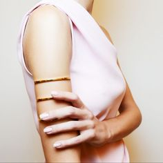 Nail Polish Color To Try: Petal - Petal pink nails might seem somewhat plain but give them a good three-coat job and add a subtle gold stripe at the base of nails and the look feels incredibly romantic and not at all basic. Girls with longer nails, this hue is for you.Photo: Christian Louboutin
