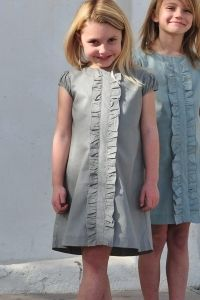 girls dress...i really hate to repin because the link is for an online shop and this is no longer available so this is all there is...however, i love the look and the ruffle down the front.