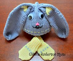 Floppy-eared Bunny hat with coordinating thumbless mitts. Five sizes in medium preemie (3-5lbs) thru toddlers (1-3 years). Less than one skein main color yarn for preemie/newborn size; two skeins for larger sizes. Knitted using easy care yarn for delicate machine wash and dry or hand wash and lay flat to dry. Facial details finished with sew-on eyes and/or hand-detailed fabric paint.