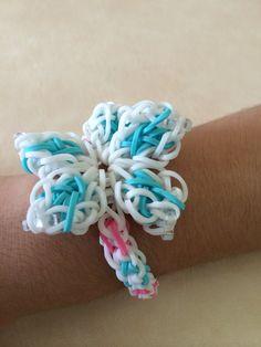 Rainbow Loom frozen theme. Bracelet: inverted fishtail, snow flakes: hibiscus flower.