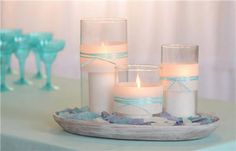 Votive Wrap Centerpiece:  Create a sophisticated centerpiece in a few easy steps. Wrap votive holders with BRIDES adhesive vellum wraps and ribbon. Place on a charger and garnish with sea glass.