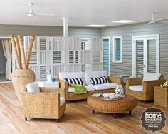 "All rooms open onto this informal entertaining space, built by owner John. An innovative white screen provides visual interest. ""His inspiration was a Besser block wall of an old building we saw in Manly, combined with the look of plantation shutters."""