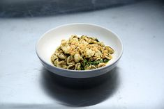 Orecchiette with Sausage and Broccoli Rabe PestoRecipe courtesy L'ApicioServes 4 to 6 Ingredients:1⁄2 bunch broccoli rabe1⁄4 cup pine nuts, toasted2 cloves of garlic (germ Removed)1⁄4 cup parmesan1⁄2 tsp kosher salt plus more for seasoning water1⁄2 pound Italian Sausage (uncase before using)1 Cup diced white onion1⁄2 cup chicken stock1⁄4 cup white wine1⁄2 cup olive oil12 oz orecchiette