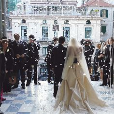 Brides.com: Sarah and Francesco in Amalfi, Italy. Upon emerging from the cathedral following their ceremony (conducted in English and Italian), Sarah and Francesco were greeted with cheers from people in the palazzo and surrounding buildings and showered with confetti.