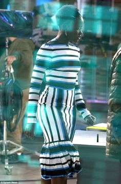 Stripes: Showcasing her slim waist, Lupita uncovered her hair which was worn natural with ...