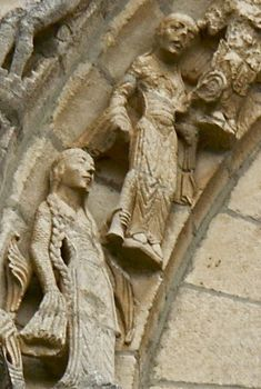From the Church of Benet, dedicated to Ste. Eulalie, Vendée, western France, 12c sculpture. A procession of women carrying candles from the Romanesque façade of the church. It looks like the two female figures have side laced gowns, probably also with gores at the sides, judging from the extra pleats there...