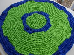 This Spunky Original Design House Rug is 25 inches round and a colorful addition to your home.