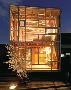 The timber-framed rooms of this house in Osaka prefacture by Japanese architects Suga Atelier are on show to the street though a transparent facade. Named House of Cedar, the building has a cross-bracing cedar structure that is exposed inside both of its two storeys