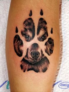 Dog Face In Paw Print Tattoo Design For Leg