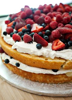 Fruit Basket Cake recipe - Yellow Buttermilk Cake layers, with a Lemon Filling, freshly whipped cream and lots of berries. #cake #fruit #lemon