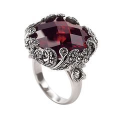 Beltane Summer bonfires of Celtic lore inspire the design of this superb ring! A cabochon of checker-faceted garnet cubic zirconia, accented with genuine marcasite in an elaborate setting of antiqued sterling silver. Beautiful!