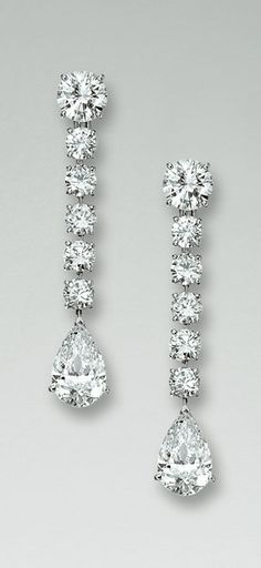 "PAIR OF DIAMOND PENDENT EARRINGS, ""NIAGARA"", CARTIER Each brilliant-cut diamond weighing 1.63 carats respectively suspending a line of five brilliant-cut diamonds terminating in a pear-shaped stone weighing 3.43 and 3.60 carats respectively, signed Cartier and numbered, French assay and maker's marks."