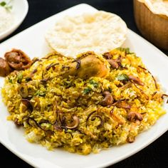 Thalassery Chicken Biriyani is a classic heritage dish from the Thalassery region in Kerala, South India.