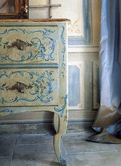 """""""I have actually created walls like this years ago. I would use Benjamin Moore 926 as my base and use an ocher and blue gouache paint glaze over it. The delicate cartouche designs on this little chest are perfect with the shape of the leg."""" Amy Howard"""