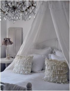 Shabby chic bedroom with canopy & chandelier