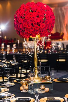 Elegant red roses floral centerpiece. http://www.maharaniweddings.com/gallery/photo/97689