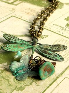 necklace of brass patina on dragonfly, insects, flowers, bee