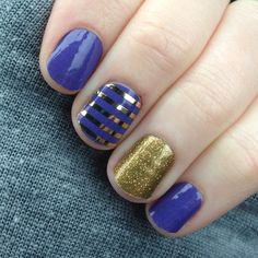 I think this is one of my favorite #manicures ever. But then again, I say that every time. #jamberry #jamberrynails #notd #nailart #berrybluejn #goldsparklejn #MetallicGoldPinstripeJN #IGetPaidToHavePrettyNails
