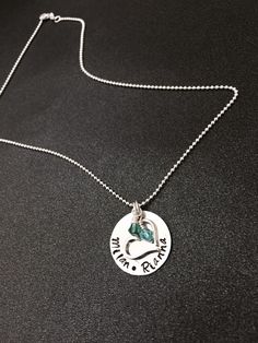 A personal favorite from my Etsy shop https://www.etsy.com/listing/207626237/hand-stamped-family-tree-necklace-hand