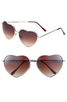 Heart shaped sunglasses make everything more lovely.