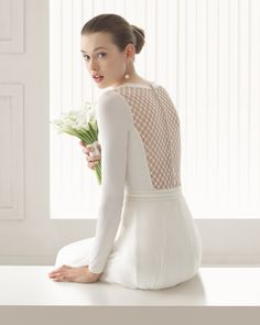 Maid of honor Beaded tulle knit body and silk chiffon skirt with hemstitch detailing in a natural colour.
