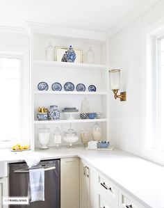 A gorgeous display of blue and white accessories and dishware on open shelving is sophisticated and elegant.