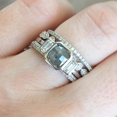 Ice cold Damond stacks - a grey rough diamond pairs perfectly with our signature bands. Available now in 14k white gold at sarah o jewelry in denver, co. #sarahojewelry #roughdiamond #threestonering #alternativebride #uniqueengagementring #ringstagram #engagementring #stackingrings #weddingbands