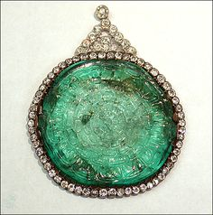 Historic Mogul Emerald Pendant. A hallmark indicates that the Mogul emerald was set into the pendant and necklace in France around the turn of the 20th century.