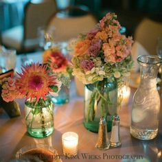Mason Jar Centerpiece: --- The few tinted jars  the beautiful colors ( sticking to one color to me can be quite boring) but this is just precious❤