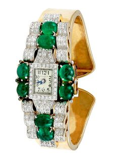Hamilton Diamond & Emerald Watch, 27mm by Estate Fine Jewelry, they make beautiful timepieces, I can imagine this must of been custom~