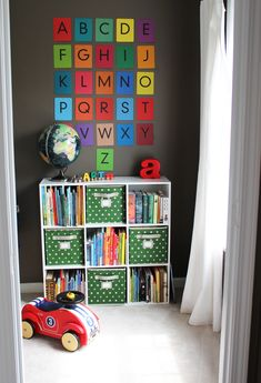 A modern, colorful bedroom for a big boy bed, plenty of toys and books, and room to grow.