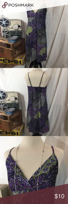 Cute Summer Dress Tracy Lynn Summer Dress.  Dress is a mixture of purple, green, and white patterns.  Dress has adjustable straps and elastic at the back shoulder area.  Dress is 95% Polyester and 5% Spandex and is in excellent condition. Dress is from a smoke free, cat free home.  (C1-19) tracy lynn Dresses Midi
