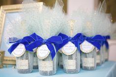 Custom wrapped mini champagne bottle favors by Lovelyfest. Fun favors that all guests will enjoy!   Lovelyfest Event Design   Royal Blue Baby Shower