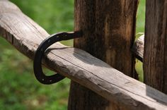 split rail fence held together with horse shoes.