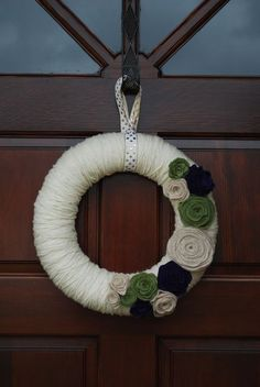 Yarn wreath felt flowers. beautiful colors and soft texture.