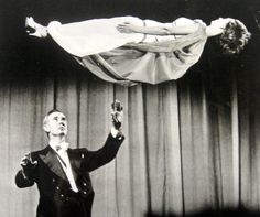 Magician Lee Grabel levitating his wife on stage